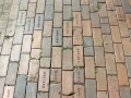 The uncovered bricks shows years of foot traffic